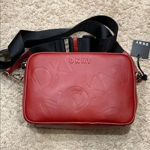 Brand new DKNY red bag with tags. Slight denting